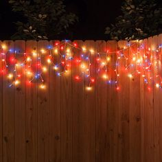 We can't get enough of these icicle lights! They're so easy to hang up (we used our icicle light clips) and instantly add ambiance - brightly illuminating the night. Backyard String Lights, Backyard Lighting, Icicle Lights, Hanging Lights, 4th Of July Decorations, Christmas Decorations, Holiday Decorating, White Wire Christmas Lights, Light Clips