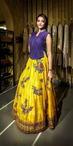Pretty yellow lehenga with the contrast purple blouse Half Saree Designs, Sari Blouse Designs, Dress Neck Designs, Lehenga Designs, Lehenga Skirt, Anarkali Dress, Lehnga Blouse, Indian Gowns Dresses, Baby Dresses