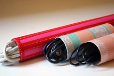 Cable organizers made from cardboard rolls, craft paper and washi tape.