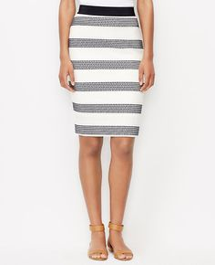 """Beautifully banded with embroidered dots, this is the skirt of the moment: slim, sleek and graphically gorgeous. Slightly more fitted at the waist. Our curviest fit, curvy through the hip and thigh and roomier at the back. Elastic grosgrain waistband. Exposed back zipper with snap closure. Back vent. Lined. 22"""" long."""