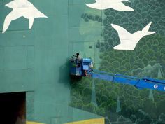 """Definitely """"larger than life"""" is this 2,100 square meters mural by Rustam Qbic located in Moscow, Russia. Apart from beautification, the façade artworks were meant to symbolize the power and importance of communication and our power to improve our surroundings. #color #travel #world #colorful #outdoor #mural #art #artwork #streetart #facade #Russia"""
