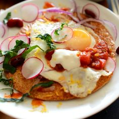 Crispy, gluten free breakfast tostadas made with baked brown rice tortillas, over easy eggs, fresh veggies, salsa...