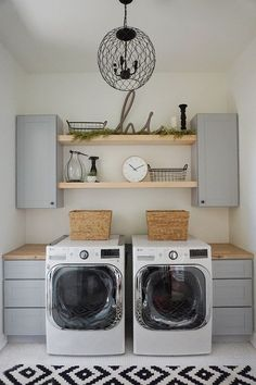 Farmhouse Laundry Room Open Shelves. Since you can see into our laundry room, I wanted it to flow with the style of the rest of our house. So we kept it, clean, modern and a little rustic! We LOVE the open shelving and functionality of the space and the light, rug and decor give it a pop of style! The farmhouse-style laundry room features open shelves, gray shaker cabinets, butcher's block countertop and penny floor tile. Farmhouse Laundry Room Open Shelving Ideas. Laundry Room Open Shelves…