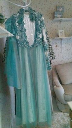 Aira in blue dress