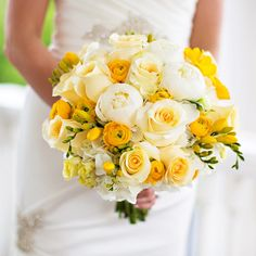 The bridal bouquet was full of white peonies and roses and yellow ranunculuses and freesias.