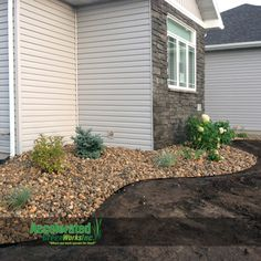 Aluminum edging creates a sleek look of separation between landscaping beds and lawn.