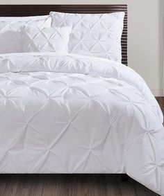 Adorn your bed with this stylish comforter set that adds a softer touch for a better night's sleep while also dazzling the boudoir's design. Plus, it is machine-washable for easy cleaning.Includes comforter, two shams and throw pillow100% polyesterMachine washImported