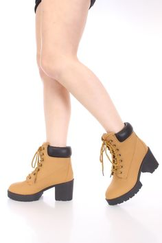 Be comfy yet stylish this season with these fashionable booties! They will go perfect with your favorite romper or skinnies! Make sure you add these to your closet, they are definitely a must have! The features include a nubuck faux leather upper with a lace up tie design, round closed toe, stitched detailing, rubber traction soles, puffed trim, smooth lining, and cushioned footbed. Approximately 3 inch chunky heels 1 inch platform.