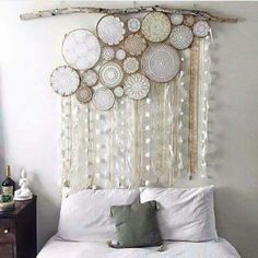 From Vintage Pixie, beautiful wall art of gathered dream catchers made from embroidery hoops and doilies with long tails of different ribbons and pompoms