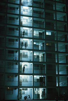 Residents of an apartment block cool down in the night air, Singapore, 1962 Photograph: Winfield Parks/National Geographic/Getty Images