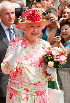 Queen Elizabeth II on a walkabout at Queen's Park during her visit to Canada. What a beautiful dress for the Queen.