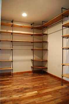 Easy DIY closet shelves, perfect for a master closet. Diy Pipe Shelves, Wood Shelves, Pipe Shelving, Floating Shelves, Diy Closet Shelves, Pantry Shelving, Plumbing Pipe Shelves, Basement Shelving, Basement Stairs