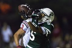 Jayshawn Gates-Mouton latches on to one of his two receptions for 41 yards during Palo Alto's 48-0 victory over visiting Gunn in nonleague action Friday night. Photo by GRANT SHORIN/THE VIKING
