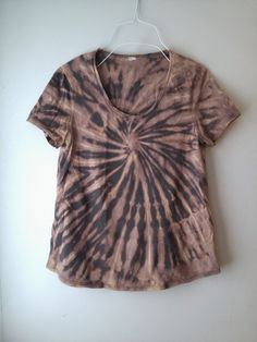 spiral tie dye on coal grey loose cotton tee t shirt, light tan with purple undertones dye removal bleach dye spiral tie dye t shirt