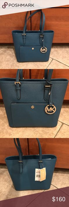 NWT Michael Kors medium snap pocket steel blue New with tags Michael Kors medium snap pocket tote purse! Leather! Color is beautiful steel blue! Love this purse! Looking to sell only unless u have a MK bag or coach bag I want ;) Michael Kors Bags Shoulder Bags