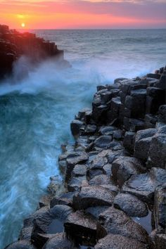 The Giant's Causeway is a magnificent basalt rock formation located on Ireland's northeast coast. The tops of the incredible hexagonal basalt columns form stepping stones to the ocean.