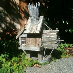 Hand-crafted rustic bird-house - looks like fairy tale or Carmel on the beach cottage - bought it at a  garage sale.  Adorable details, hard to capture in a photo.