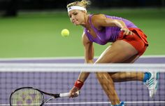 Maria Kirilenko colorblocking with a purple and red ensemble from Adidas.  #tennis