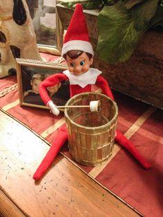 Whizzle roasting marshmallows over candle! Elf on the Shelf idea.
