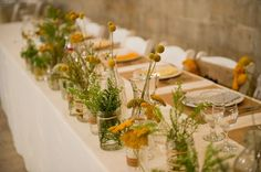 barn wedding rustic floral centerpieces Credit via Ruffled