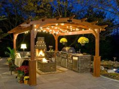 I just love this!  Everything about it, the pergola, the fireplace, the grilling/cooking area.  Aaahhhh