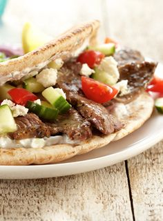A dinner idea that's different AND easy to make: Pitas stuffed with boneless lamb and topped with a tangy tzatziki.