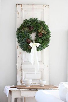 white decor, gorgeous green wreath. love, love, love