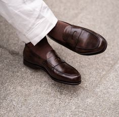 The iconic loafer by John Lobb. First introduced in 1950, it features a neat saddle and a hand stitched apron, remaining a favourite through the generations due to its timeless style and impeccable quality of construction. Men's Shoes, Dress Shoes, Classic Elegance, Timeless Fashion, Loafers Men, Apron, Oxford Shoes, Menswear, Construction