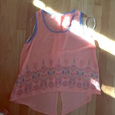 Fashion blouse tank top Never worn but without tags light coral color with light blue and green and a dark coral sticking design Mine Tops Blouses