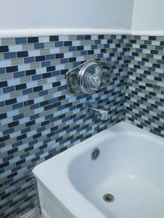 Brother Vs. Brother Episode One: #TeamDrew Bathtub Tile Surround After (http://www.hgtv.com/brother-vs-brother/brother-vs-brother-photo-highlights-from-episode-1/pictures/page-32.html?soc=Pinterest)