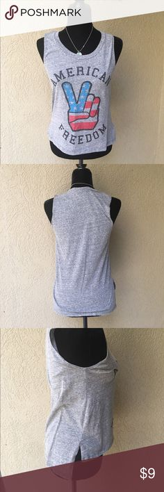 """❤️ Closet American Freedom Tank ❤️ Closet American Freedom tank in a heather grey with peace hand sign printed in American Flag, back is slightly longer than the front. 16"""" Bust 21.5"""" length in front 24.5"""" length in back . EUC no stains or holes ✅I ship same or next day ✅Bundle for discount ❤️ closet Tops Tank Tops"""