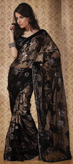 black sari with golden/silvery (hard to tell in a picture) delicate flowers.usually I go for colorful but this is beautiful - royal, The sari and whole outfit- elegant and funky all in one India Fashion, Ethnic Fashion, Asian Fashion, Indian Dresses, Indian Outfits, Indian Clothes, Beautiful Saree, Beautiful Dresses, Black Saree