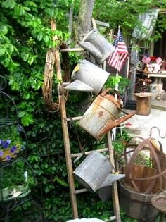Repurposed ladders in the garden Not only do ladders add height and interest, but provides open storage like a set of funky shelves. See our best Flea Market Gardening ideas and some fun projects you can do!