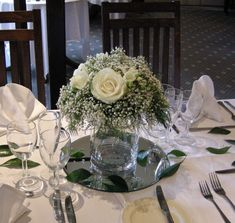 28 Amazing Wedding Table Arrangements- this is SO genius financially. free leaves, some airy fern, a bunch of baby's breath and very few actual flowers.
