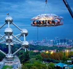 Dinner in the Sky, Brussels, Belgium is an unusual restaurant concept where diners and waitstaff are hoisted up with a crane along with a large custom-made dining table. A gourmet dinner is then served 160-180 feet suspended in the air.