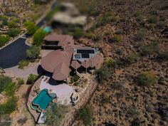 A Custom Home nestled on a spectacular hillside high elevation 3.8 acre lot in Scottsdale Mountain wants $2M