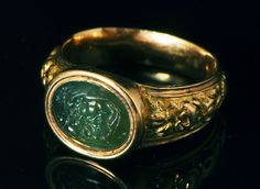 A roman intaglio of Lion and stag, set in a 19th century gold ring.