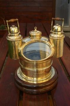 """Rare Museum Quality- """"Mushroom"""" brass yacht binnacle by Cornelius Knudsens Circa 1870 by Cornelius Knudsens Solid brass yacht binnacle by Cornelius Knudsens. Fitted with gimbaled compass, mushroom top with two oil lamps in oval window. Vintage Compass, Brest, Cornelius, Oil Lamps, Decoration, Solid Brass, Stuffed Mushrooms, Museum, The Sea"""
