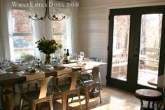 Kitchen/dining room - love the table, chairs, stools, whitewashed paneled walls and black doors! I pretty much love everything!