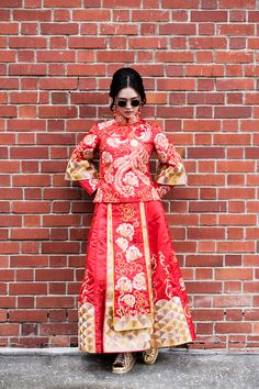 Bride in traditional Chinese qun kua and gold sneakers for pre-wedding shoot // Keeping It Cool in Kua: Amos and Laura's Engagement Shoot