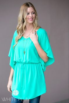 "The Caterina Tunic Dress is the ultimate getaway dress! Made with a comfortably relaxed fit, elasticized waist with a drawstring and fluttery sleeves, you'll want to throw have it in your suitcase no matter where you're headed! Pair with solid capri leggings and flats for a busy day or with white skinnies and wedges for a fun night out!Colors AvailableMintCoralRoyalSizes AvailableSmall (0-4)Medium (6-8)Large (10-12)Women's sizingModel is 5'9"" - wearing size smallPolyesterHand wash cold…"