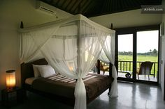 Serene and spacious bedroom overlooking rice paddy field. Max's. Tegalalang.