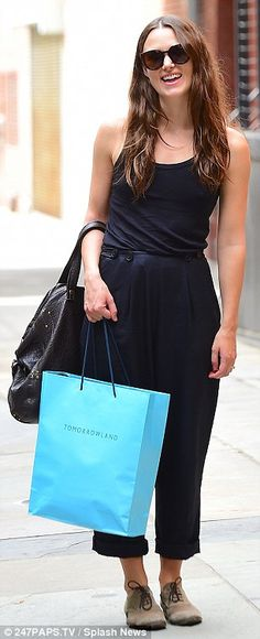 Shopping up a storm:Keira looked gleeful as she strolled the streets wearing the oversize...