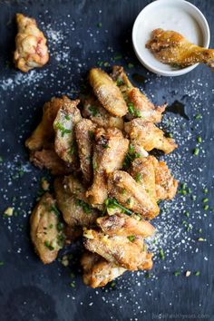 CRISPY GARLIC PARMESAN CHICKEN WINGS - baked instead of fried but these classic chicken wings are still as crispy and delicious as ever! The perfect party appetizer or game day treat! | joyfulhealthyeats.com | Gluten Free Recipes