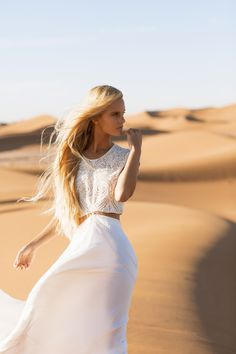 IMG model Hanalei Reponty is lensed by photographer Jennifer Stenglein for wedding website The Lane. Karissa Fanning styles Hanalei in breezy white cutouts, strangely at home on North African sands.