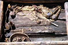 The mummy -- remains of a warrior -- is almost 2,500 years old. He is wearing...
