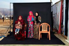 People, 3rd prize singles. Portrait of a Syrian refugee family in a camp in Bekaa Valley, Lebanon, on Dec. 15, 2015. The empty chair in the photograph represents a family member who has either died in the war or whose whereabouts are unknown.