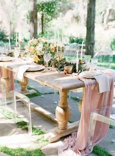 Acrylic Louis chairs provide an airy, modern edge to this country trestle table and romantic setting. Via Oak & The Owl