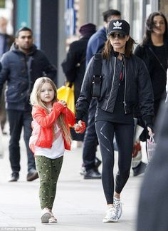 Beckham takes Harper, for a morning stroll in London Mother and daughter time: Carrying a bag of bubble drinks, she held hands with little Harp.Mother and daughter time: Carrying a bag of bubble drinks, she held hands with little Harp. Victoria Beckham Outfits, David And Victoria Beckham, Victoria Beckham Style, Victoria Style, Vic Beckham, Harper Beckham, Mode Des Leggings, Celebrity Sneakers, The Beckham Family