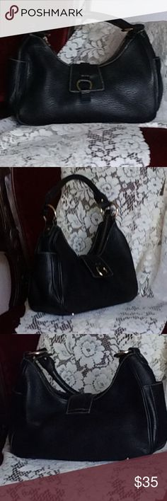 Beautiful leather,Talbots shoulder bag. Talbots black leather shoulder bag. 111/2 inches wide by 8 inches tall with a 13 1/2 inch shoulder drop. This bag has one inside zipper pocket and two outside pockets, one on each end. This bag is in excellent condition. Talbots Bags Shoulder Bags
